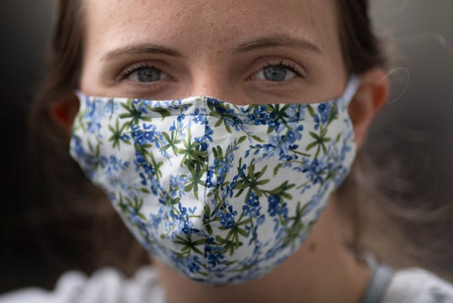 Erin Deeds wears a mask with Blue Bonnets  Wednesday, May 6, 2020 in Nashville, Tenn.