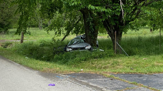 Two McGavock High School students died from injuries sustained when a car they were in lost control on Couchville Pike and struck a tree on Wednesday.