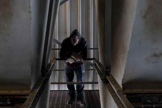Doug Evans watches as feed fills a grain truck on Tuesday, May 5, 2020 at Heimerl Farms in Johnstown, Ohio. Brad Heimerl, the farm's owner, is struggling to get his hogs to processing plants due to the COVID-19 pandemic.