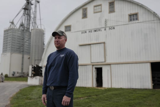 Brad Heimerl poses for a portrait at his farm on Tuesday, May 5, 2020 at Heimerl Farms in Johnstown, Ohio. Heimerl, the farm's owner, is struggling to get his hogs to processing plants due to the COVID-19 pandemic.
