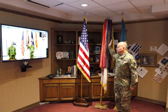 Brig. Gen. David Trybula, takes the oath with Maj. Gen. Joel Tyler via video teleconference. Normally conducted face to face, this promotion ceremony, like many during the COVID-19 pandemic, was done remotely, with only Trybula's family and a minimum staff present in keeping with social distancing guidance.
