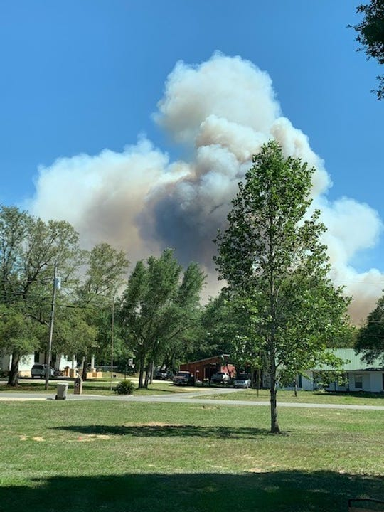 Smoke from a 100-acre wildfire off of Hurst Hammock Road in Escambia County is pictured Wednesday, May 6, 2020.
