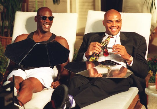 NBA superstars Michael Jordan (left) and Charles Barkley during the filming of a Nike shoe commercial at the Arizona Biltmore on Nov. 22, 1993.