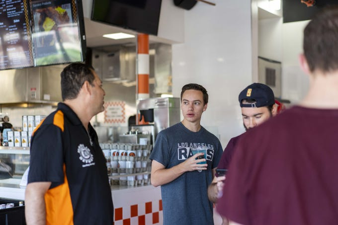 David Najor, owner of Detroit Coney Grill, talks to customers. Detroit Coney Grill planned to challenge Scottsdale after the city told restaurant operators they had to replace the orange awnings outside. City officials said the orange color did not adhere to design guidelines for the city.