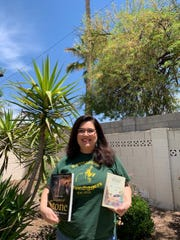 Katosha Nakai with the books she was given on a visit to Ireland as thank-yous from Irish people for her Choctaw ancestors' help during the Irish potato famine.