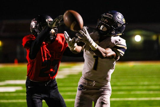 Casteel's Isaiah Newcombe battles for a ball against Williams Field.
