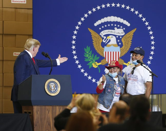 President Donald Trump acknowledges Sammy's Mexican Grill owners Betty and Jorge Rivas while speaking at Honeywell International's mask-making operation in Phoenix on May 5, 2020.