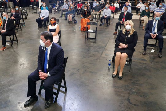 Arizona Gov. Doug Ducey (front), Sen. Martha McSally (back left) and Rep Debbie Lesko (right) wear masks while waiting for President Trump to speak at Honeywell International's mask-making operation in Phoenix May 5, 2020. Honeywell added manufacturing capabilities in Phoenix to produce N95 face masks in support of the governments response to COVID-19.