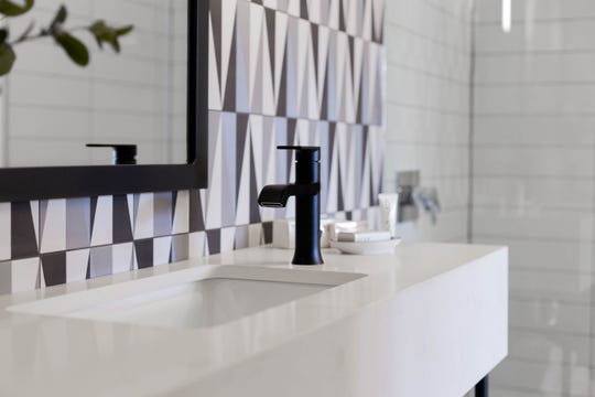 Guest bathrooms at the Tuxon Hotel have detailed tile work and rain showers.