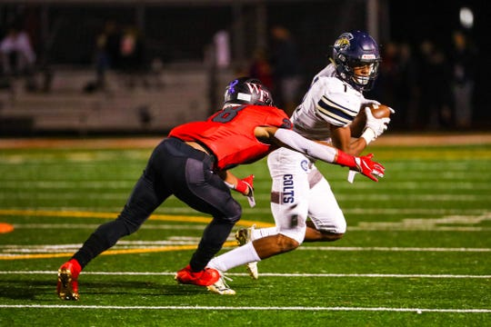 Casteel's Isaiah Newcombe evades a Williams Field tackler during a game.