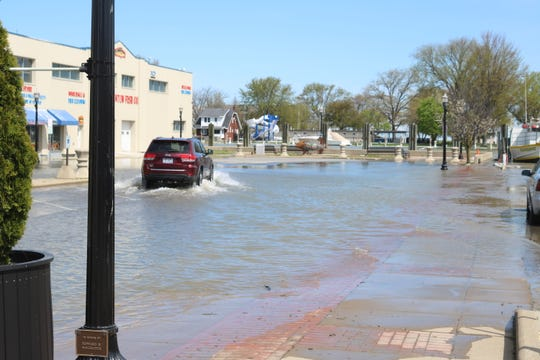 Water has once again covered the north end of Madison Street in downtown Port Clinton on Tuesday.