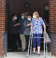 Betty Barclay, 90, walks out with a walker with  fellow resident Andrew Macenkaat New Windsor Country Inn trailing behind as they were released from the Fishkill Center for Rehabilitation and Nursing on Wednesday, May 6, 2020. The two recovered from the COVID-19 virus.