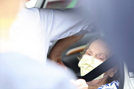 Betty Barclay, 90, says goodbye to staff at the Fishkill Center for Rehabilitation and Nursing on Wednesday, May 6, 2020. She recovered from the COVID-19 virus and returned home to the New Windsor Country Inn.