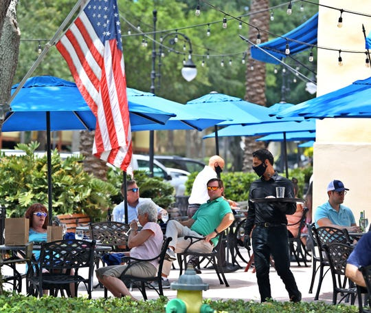 Lunch customers dine outside of Parkshore Grill, Beach Drive, St. Petersburg, Monday, May 4, 2020.  The business had been closed due to the coronavirus pandemic but reopened Monday. (Scott Keeler/Tampa Bay Times/TNS)
