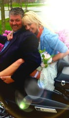 """Brian """"Tilly"""" Tillinghast (left) took Tami Fitzgerald on their first date on a Harley. They married April 4 in a ceremony cobbled together with what they could find - flowers, dress, ring and all."""