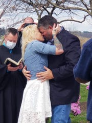 Tami Fitzgerald-Tillinghast and Brian Tillinghast wed outside of Central York High School April 4, 2020, in the midst of the coronavirus. Officiating was Magisterial District Judge John Fishel.