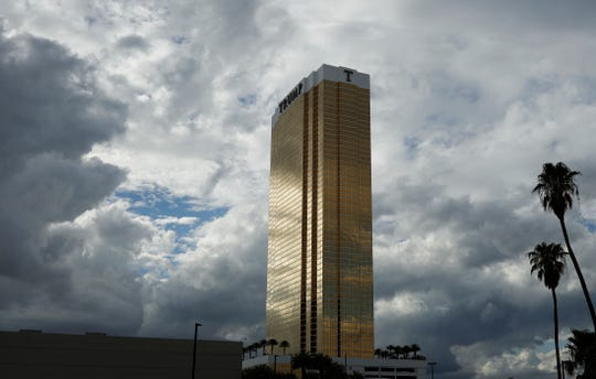 In this Sept. 21, 2016, photo, the Trump International hotel is seen in Las Vegas. Fire officials say a suspect is in custody after two separate blazes were discovered at the hotel Wednesday, April 26, 2017, in Las Vegas. The Clark County Fire Department released a statement saying toasters, towels and various other materials were used to ignite the fires at the hotel bearing President Donald Trump's name. (AP Photo/John Locher)
