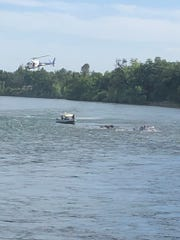 Redding police and the California Highway Patrol rescue a group of five rafters who became stranded on the Sacramento River while celebrating Cinco de Mayo on Tuesday, May 5, 2020.