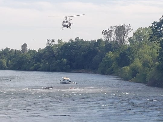 A California Highway Patrol helicopter hovers over the Sacramento River to help rescue five stranded rafters who were celebrating Cinco de Mayo on Tuesday, May 5, 2020.