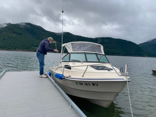 Lloyd Savage gets his boat ready for fishing Wednesday morning as access reopened at Mongold Boat Ramp at Detroit Lake.