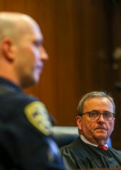Marion County Judge Thomas Hart listens to a witness, Officer Adam Waite, during trial at the Marion County Circuit Courthouse in Salem on May 5, 2020.