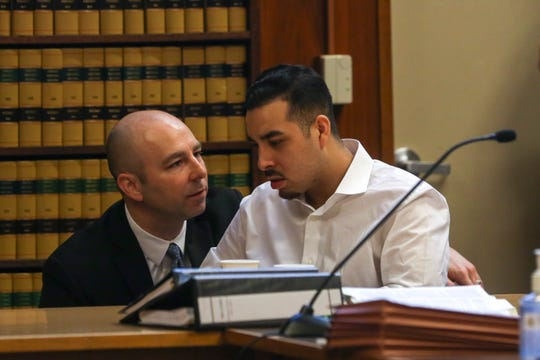 Juan Rodriguez-Palacios, 26, confers with his defense attorney, Denny Maison, during his trial at the Marion County Circuit Courthouse in Salem on May 5, 2020.