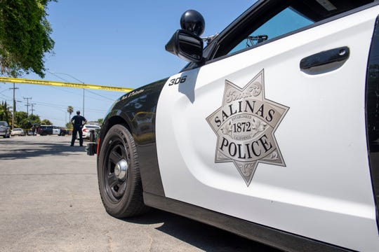FILE: A Salinas police cruiser at the scene of a shooting.