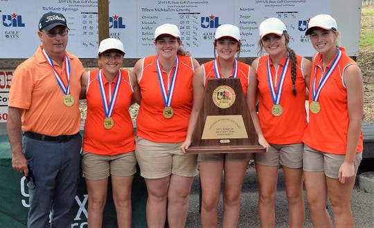 Robert Lee golf coach Kerry Gartman and the Lady Steers celebrate winning the 2019 UIL Class 1A state championship.