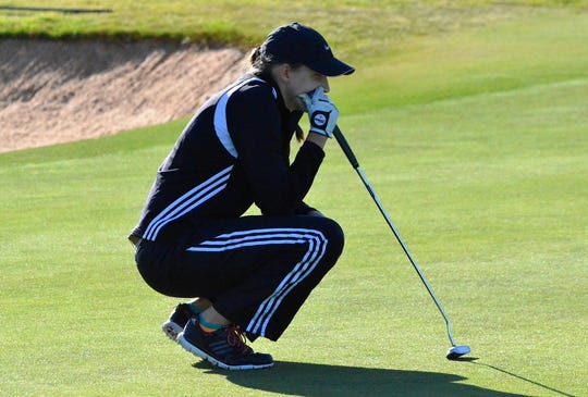 Robert Lee senior Brady Clawson reads one of the greens during the 2016 UIL Class 1A state golf tournament. Clawson helped helped the Lady Steers finish second.