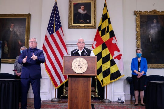 Maryland Gov. Larry Hogan announces the state could begin the first stage of its reopening process, if the rate of hospitalizations from the coronavirus and the number of patients in intensive care continue to level off into next week during a news conference on Wednesday, May 6, 2020, in Annapolis, Md. Hogan also said he is allowing elective surgery and some low-risk activities like golf, tennis, boating and fishing starting on Thursday, May 7.