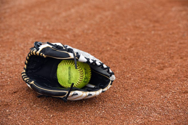 Softball gear sits on the field on Tuesday, May 5, at the Sherman Park softball complex in Sioux Falls.