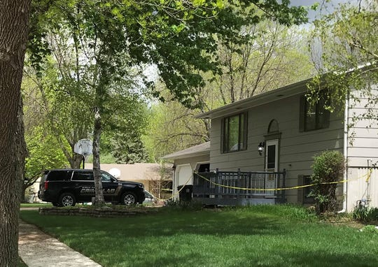 A Sioux Falls Crime Lab vehicle sits in the driveway of a home Wednesday, May 6, 2020, in eastern Sioux Falls after police say a juvenile suspect killed a man and shot a woman the night before.