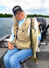 No matter what the weather, opening weekend of the gamefish season is a big event in Minnesota. Pictured: Colette Carlson.