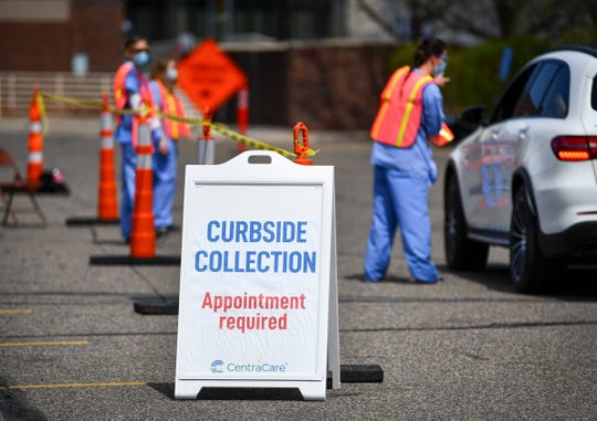 Patients are checked in and directed to the next stop at the curbside collection facility Wednesday, May 6, 2020, at St. Cloud Hospital.