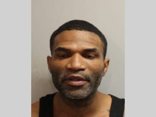 Shawn Owens, 40, is accused of robbing a woman at gunpoint as she went to her Gaines Street hotel on Tuesday morning.