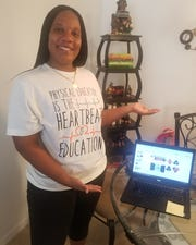 Dwan Knight, a physical education teacher at Woodville K-8 School, shows off her new teaching environment as she works remotely.