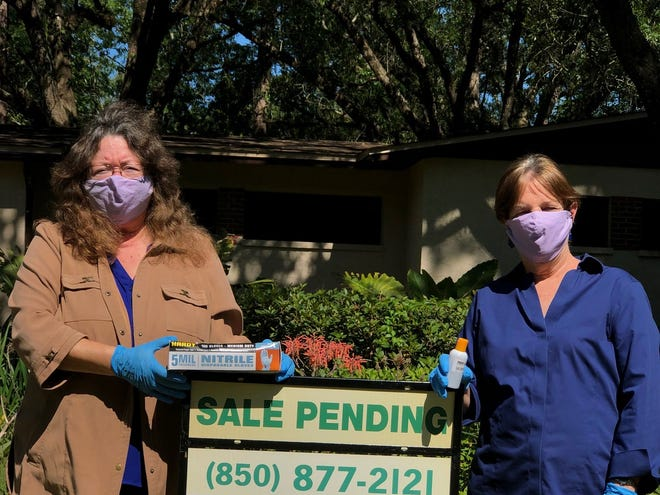 Terry and Sharon Kant-Rauch. Brokers and owners of Kant Realty of North Florida in front of a home recently listed that went under contract with two offers by day two.