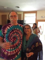 Debby Phillips and her husband Al Phillips, clad in a tie-dye shirt he made.