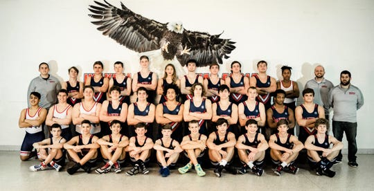 Senior Jaden Arrizola (top row, center) was the lone girl on the wrestling team at Wakulla High School.
