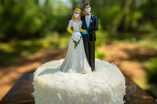 Kelsey Lovering ordered new cake toppers depicting the bride and groom in face masks after the coronavirus outbreak interrupted their original wedding plans.