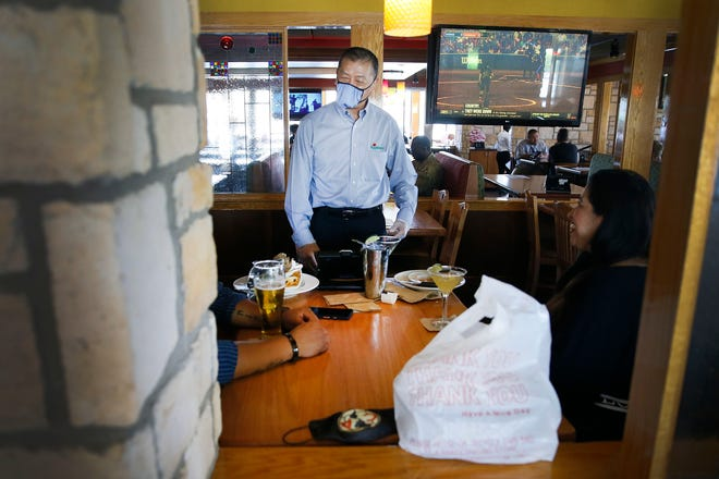 Applebee's general manager Tom Kurita checks on tables in the dining room area Wednesday, May 6, at 1766 Airway Blvd. in El Paso.  Applebee's reopened their dining rooms in El Paso on May 1 after being closed six weeks by city and county orders, as part of an effort to curb the spread of COVID-19.