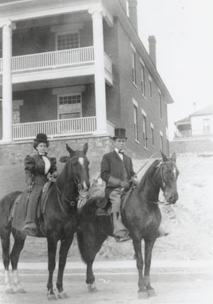 Dr. Jerome Love and wife, on horseback at the Osaple Parade in 1909.