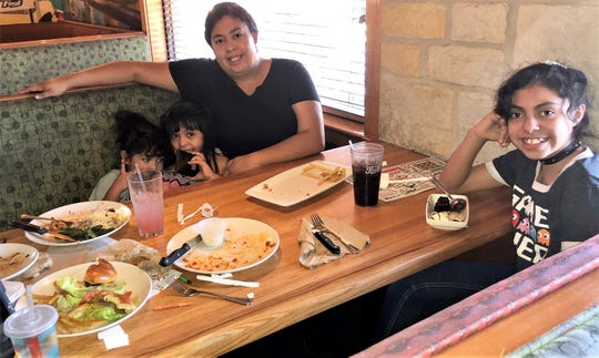 Rosemary Alvarado with three of her four children, including 10-year-old Ivy Alvarado, front, dined at the Applebee's Neighborhood Grill & Bar at 1350 George Dieter Drive in East El Paso May 5 even though the mother remained uneasy about eating out in the coronavirus era.