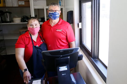 Martita's Lunch Box owners Laura and Martin Rios stand at the new drive-thru window at the 3623 Buckner St. location Wednesday, May 6, 2020, in El Paso. The restaurant responded to the coronavirus pandemic by adding the drive-thru window instead of opening the dining area under the current limit of 25% occupancy.