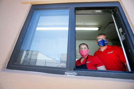 Martita's Lunch Box owners Laura and Martin Rios stand at the new drive-thru window at the 3623 Buckner St. location Wednesday, May 6, 2020, in El Paso. The restaurant responded to the coronavirus pandemic by adding the drive-thru window.