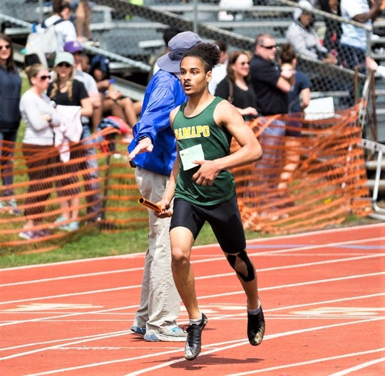 Ramapo's Nathaniel Gaines, shown here competing in a relay, will run track and play football next year for SUNY-Brockport.
