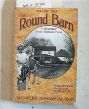 The farm house, Round Barn, Jackie Dougen and her calf.