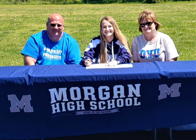 Morgan senior McKenna Schramm (middle) signed her letter of intent to run track for Ohio Valley University. Her parents, Mark (left) and Jill Schramm, are also pictured.