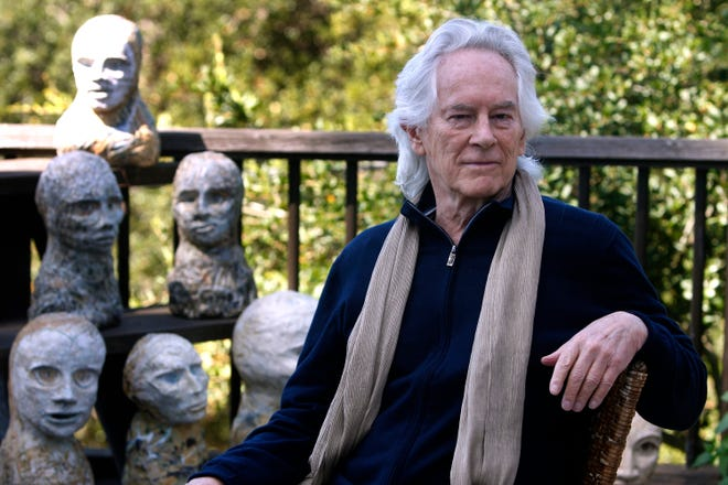 Beat poet Michael McClure on his deck with sculptures by his wife, artist Amy Evans McClure, at their home in Oakland, Calif., on Sept. 16, 2010. McClure, one of the famed Beat poets of San Francisco who went on a career that eclipsed most others in popular culture, has died. The San Francisco Chronicle reported that McClure died Tuesday, May 5, 2020, in Oakland, Calif., after suffering a stroke last year. He was 87.