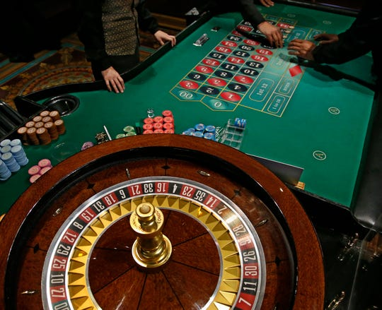 People play at a roulette wheel on the gaming floor at WinStar World Resort and Casino in Thackerville, Okla. on July 23, 2019.